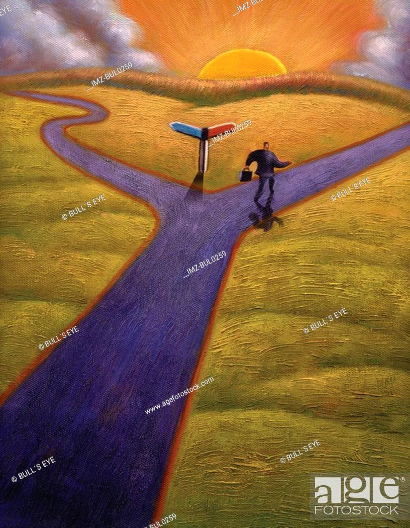 Stock Photo: Businessman taking one of two paths at a fork in the road.