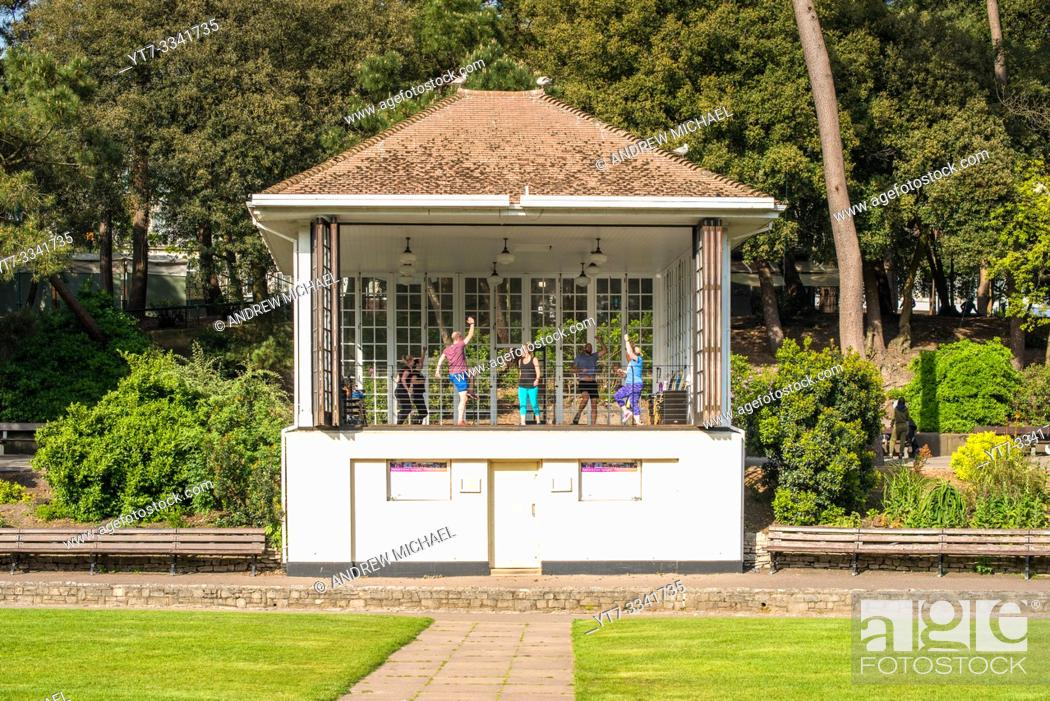 Stock Photo: An aerobics class taking place in the Bandstand on the Lower Gardens in Bournemouth, Dorset, England, UK.