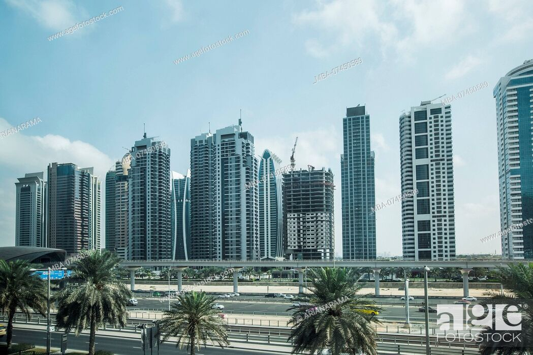 Stock Photo: Futuristic view of Sheikh Zayed Road, a big highway in Dubai and a metro station, Dubai, United Arab Emirates.