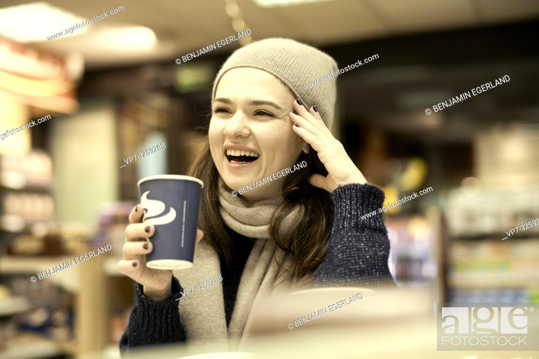 Stock Photo: woman at coffee shop, in Munich, Germany.