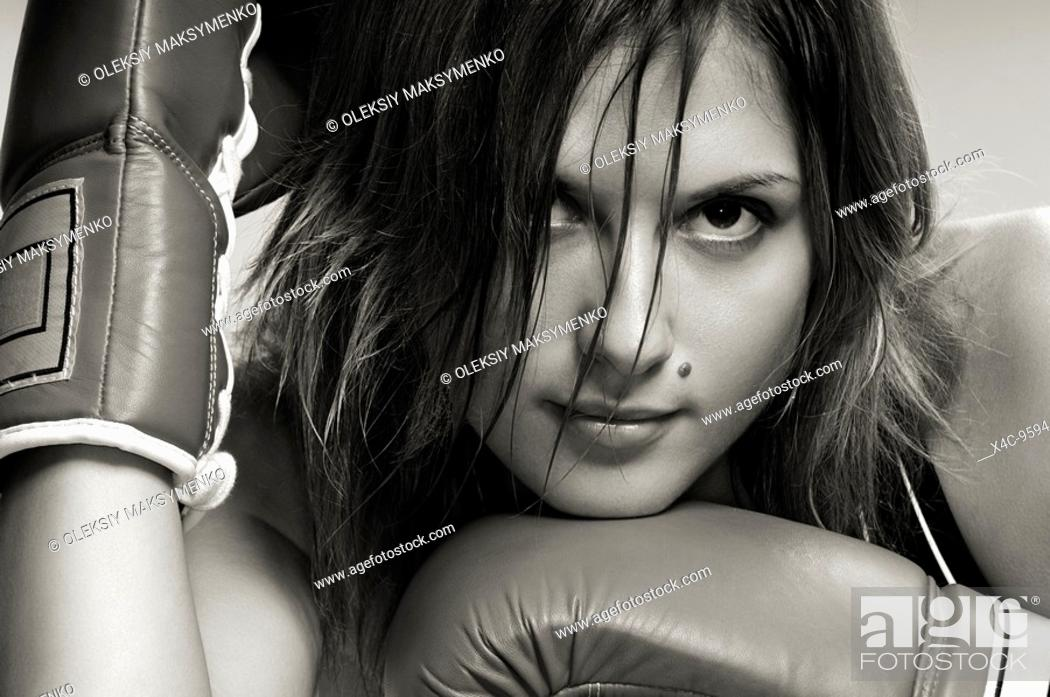 Stock Photo: Portrait of a young woman in boxing gloves.