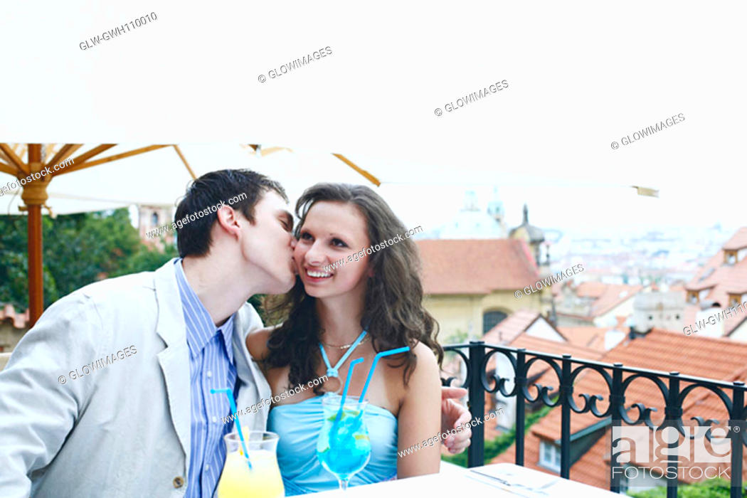 Stock Photo: Young man kissing a young woman.