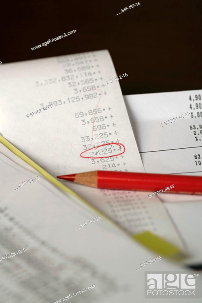 Stock Photo: Colored crayon lying on a calculation, selective focus, close-up.