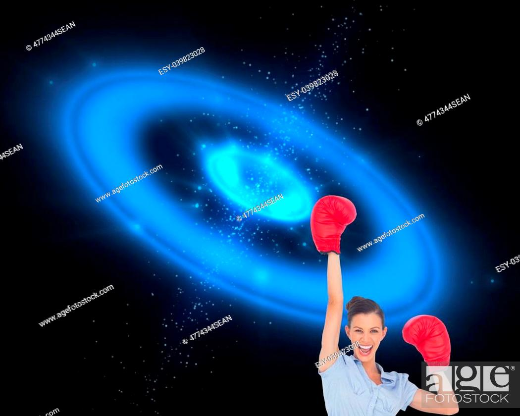 Stock Photo: Composite image of businesswoman cheering wearing boxing gloves on galaxy background.