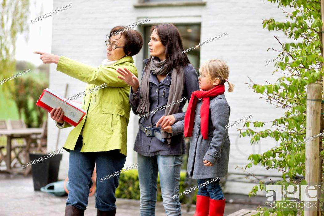 Stock Photo: Real estate agent showing woman a house.