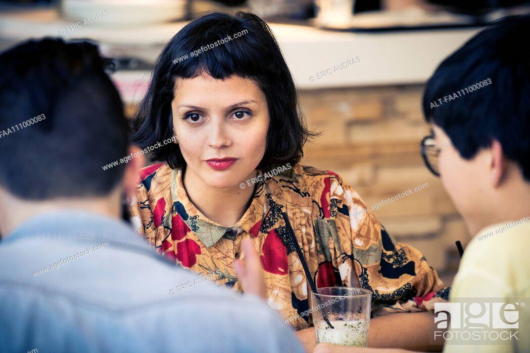 Stock Photo: Woman looking at companion.