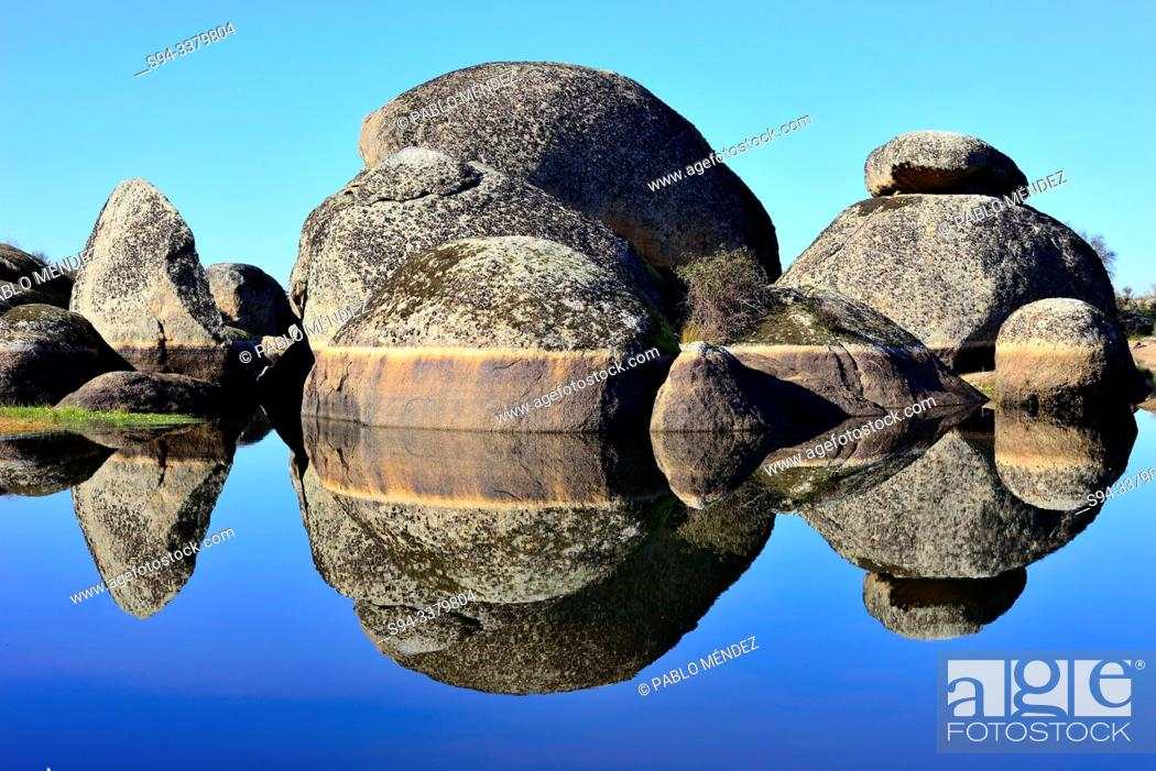 Stock Photo: Reflection in a lake of Los Barruecos, Caceres, Spain.