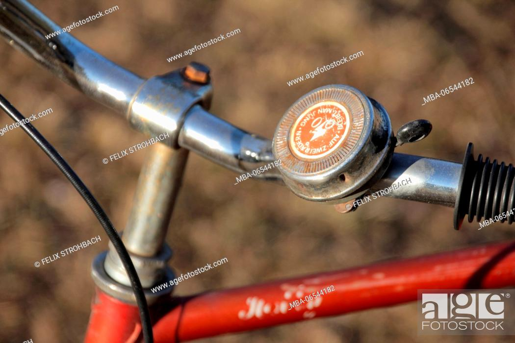 Stock Photo: An old red bicycle on a meadow,.