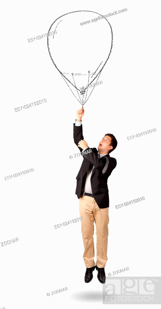 Happy man holding balloon drawing, Stock Photo, Picture And Low