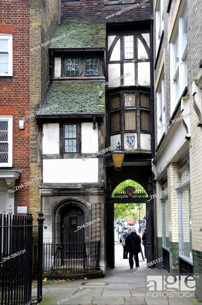 Stock Photo: London, England, UK. St Bartholemew's Gatehouse (1597) entrance to St Bartholemew's Church.