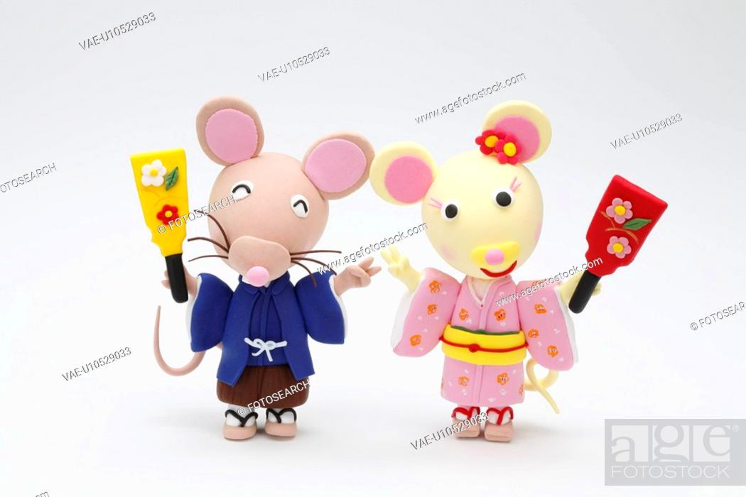 Stock Photo: Two Rats With A Battledore.