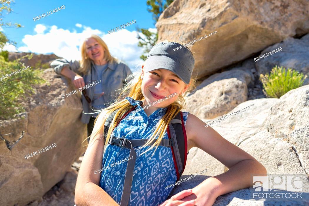 Stock Photo: Portrait of Caucasian girl and grandmother hiking near rocks.