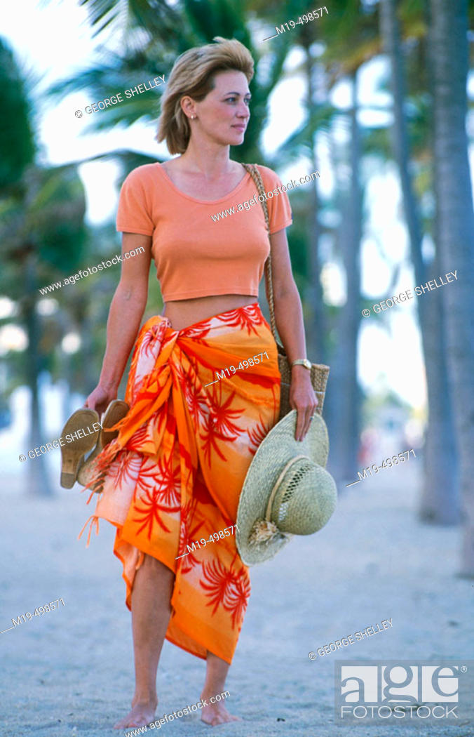 Stock Photo: girl at the beach in a surrong.