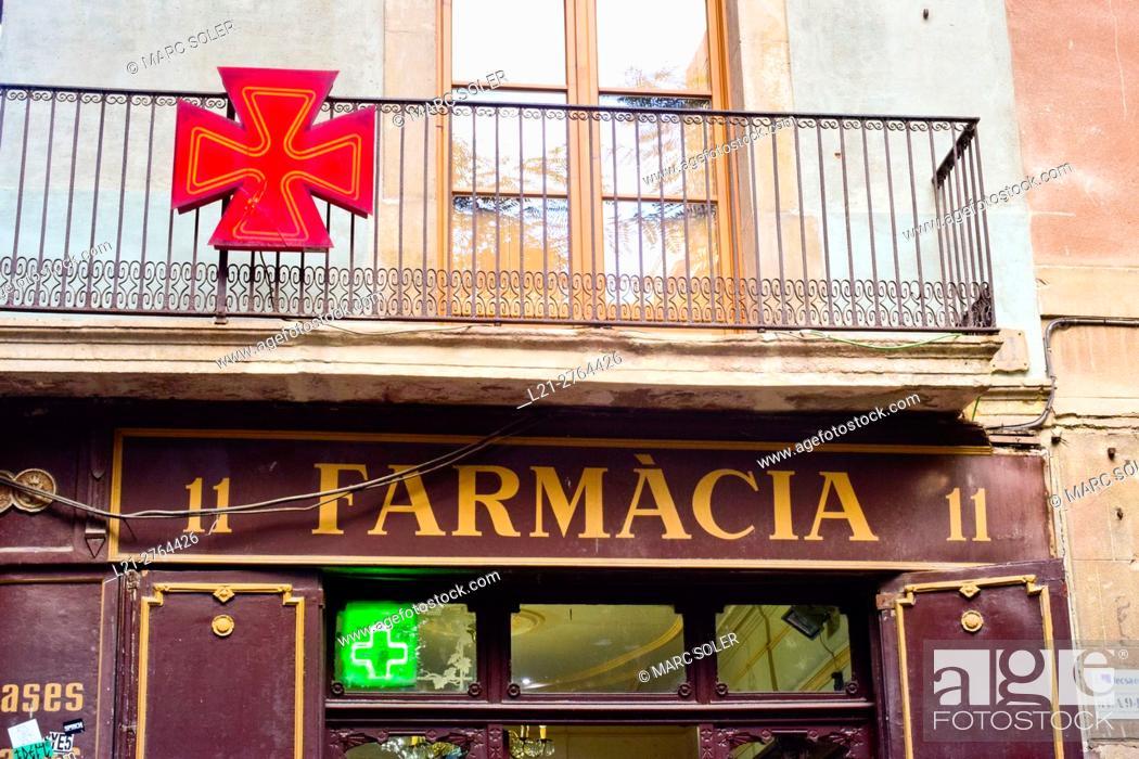 Stock Photo: Pharmacy sign in a street. Barcelona, Catalonia, Spain.