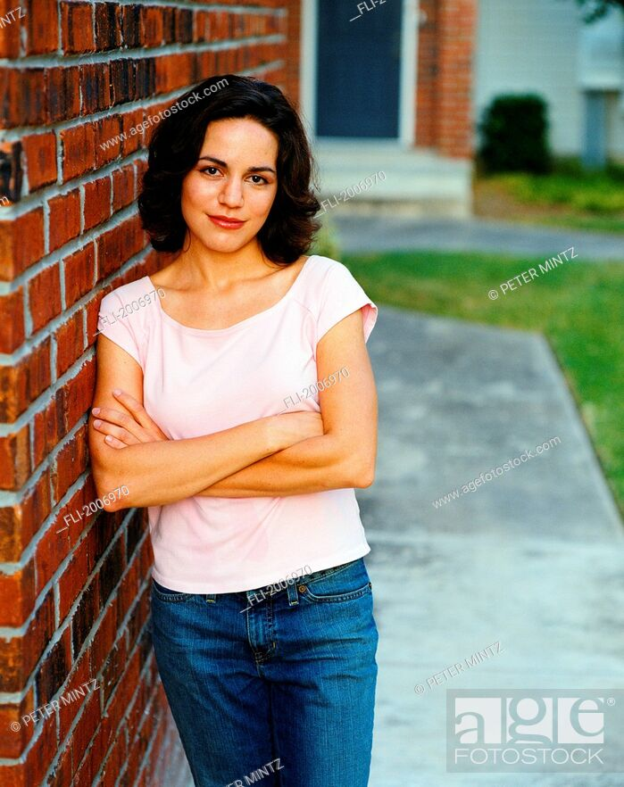 Stock Photo: Woman Leaning Against Brick Wall.