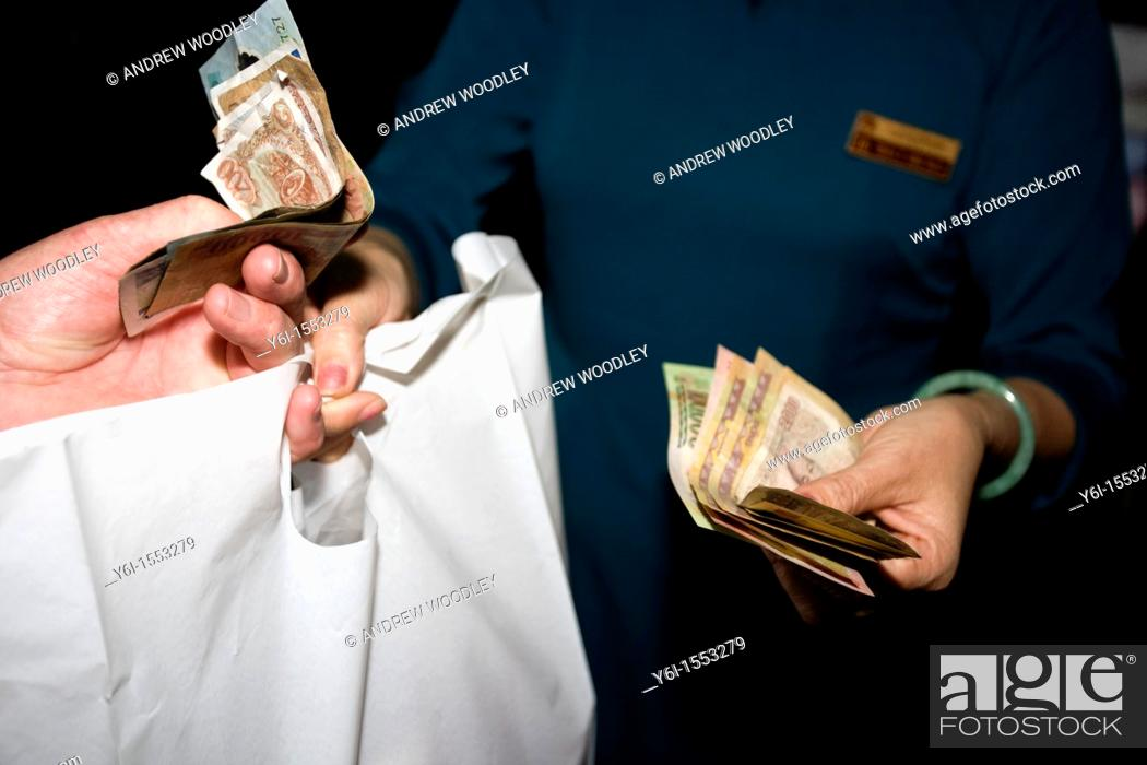 Stock Photo: Store customer receives shopping carrier bag paying cashier cash money store Hoi An Vietnam.