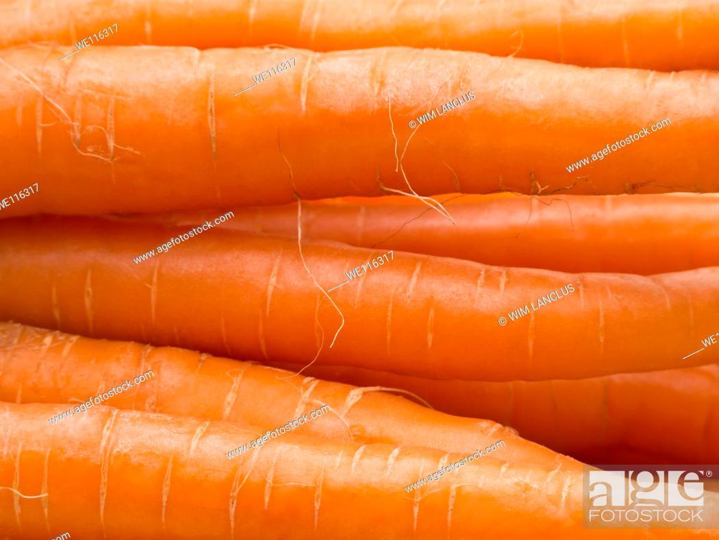 Stock Photo: Macro shot of stacked fresh carrots.