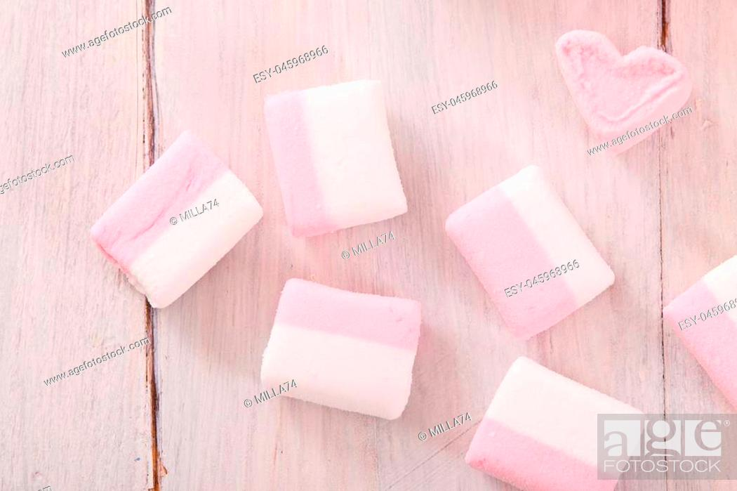 Stock Photo: Marshmallows on wooden table.