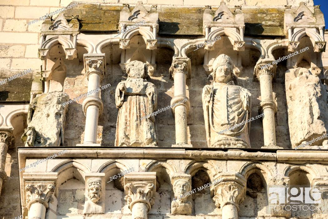 Stock Photo: Detail of Sculpture of the Facade of Collegiate Church of Saint-Martin, Village Labeled The Most Beautiful Villages of France.