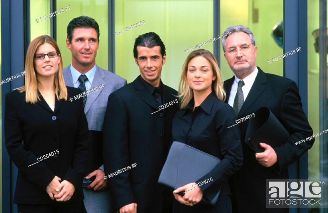 Stock Photo: Five successful executives looking at camera.