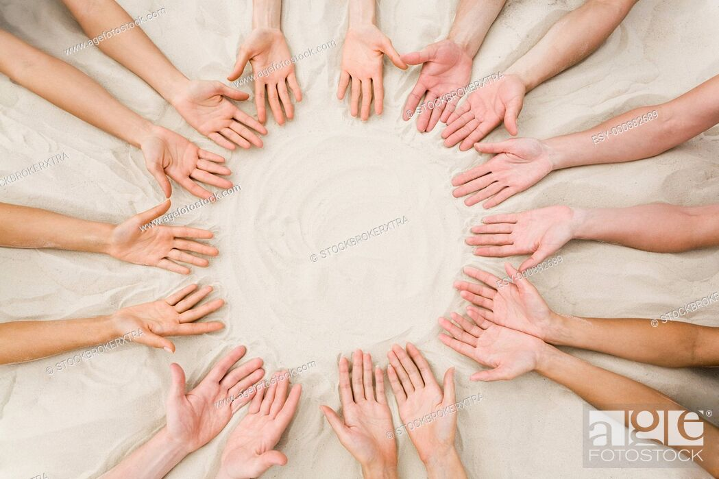 Stock Photo: Image of several friends hands on sand in the form of circle.