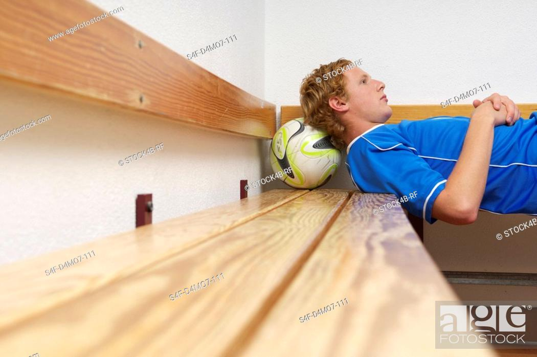 Stock Photo: Reflective kicker lying in dressing room.