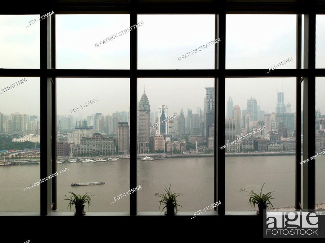 Stock Photo: Shanghai skyline seen through window.