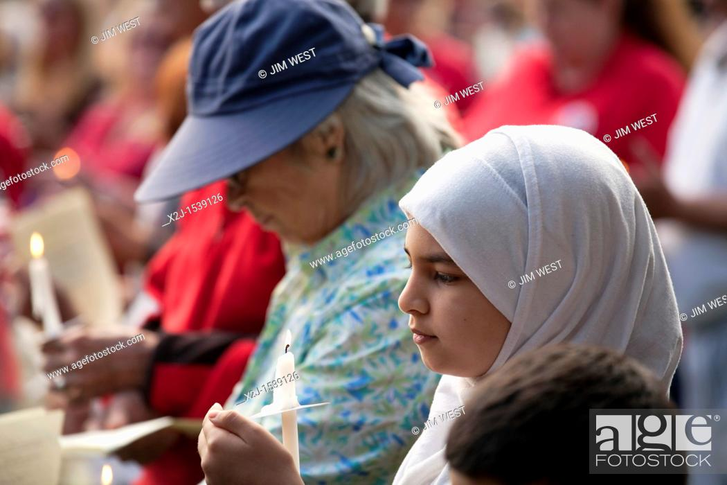 Stock Photo: Dearborn, Michigan - An interfaith 'Remembrance and Unity Vigil' at The Henry Ford museum commemorated the tenth anniversary of the September 11 attacks on New.