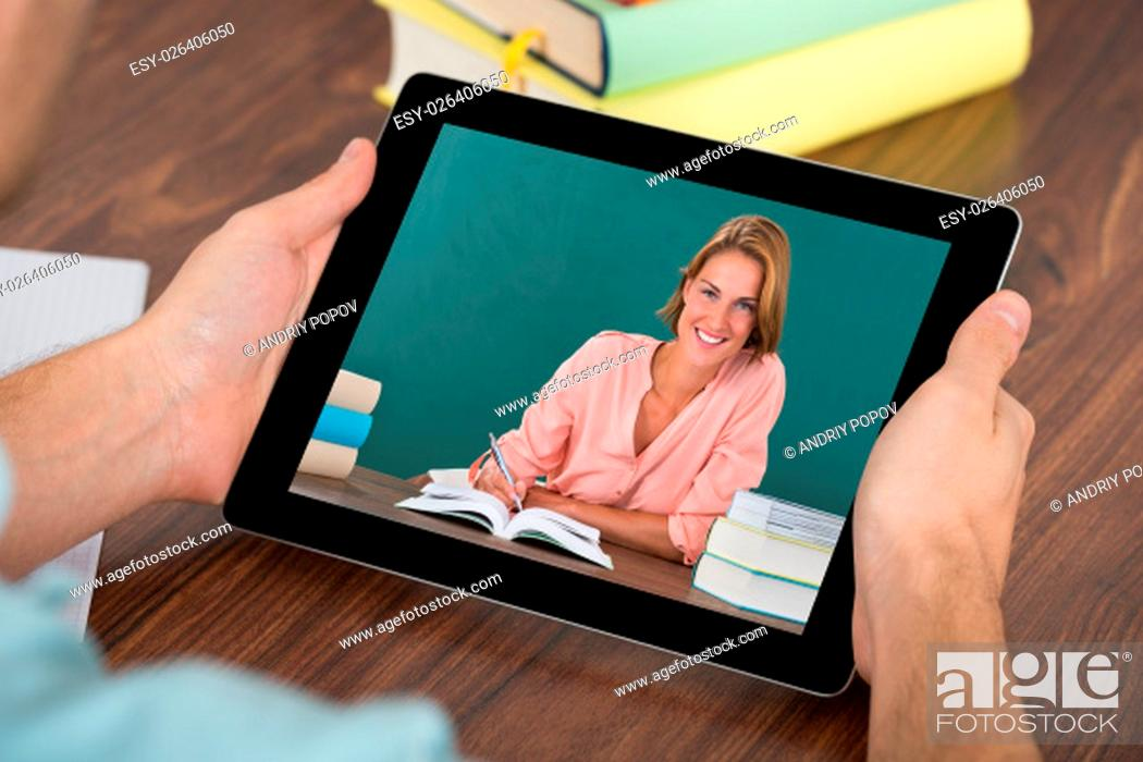 Stock Photo: Close-up Of Man And Woman Videochatting On Digital Tablet In Classroom.