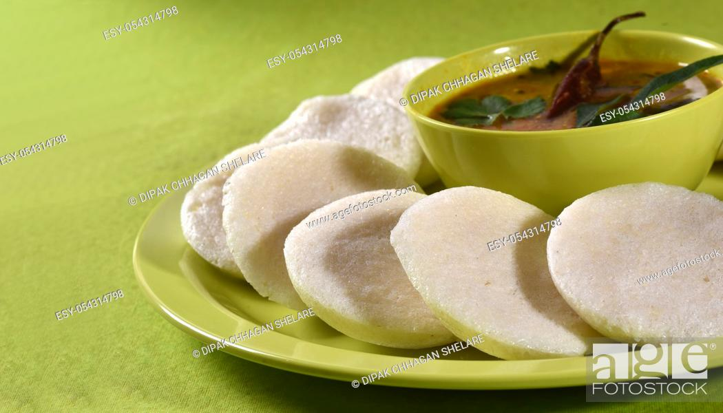 Stock Photo: Idli with Sambar in bowl on green background, Indian Dish : south Indian favourite food rava idli or semolina idly or rava idly.