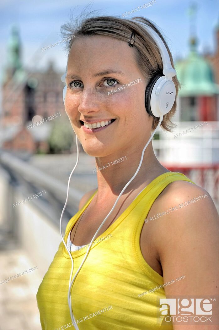 Stock Photo: Woman with headphones is going for a run.