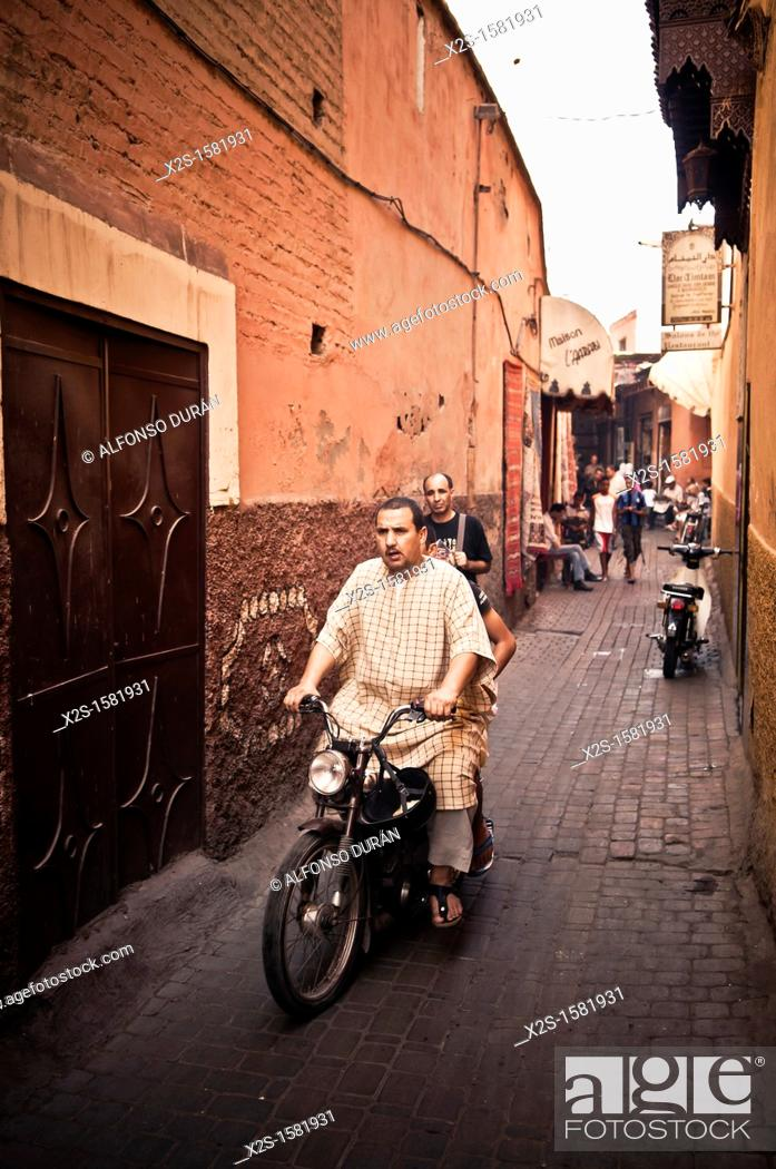 Stock Photo: Man driving a motorcycle, Marrakech, Morocco.