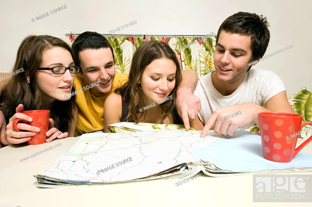 Stock Photo: Friends looking at a map.