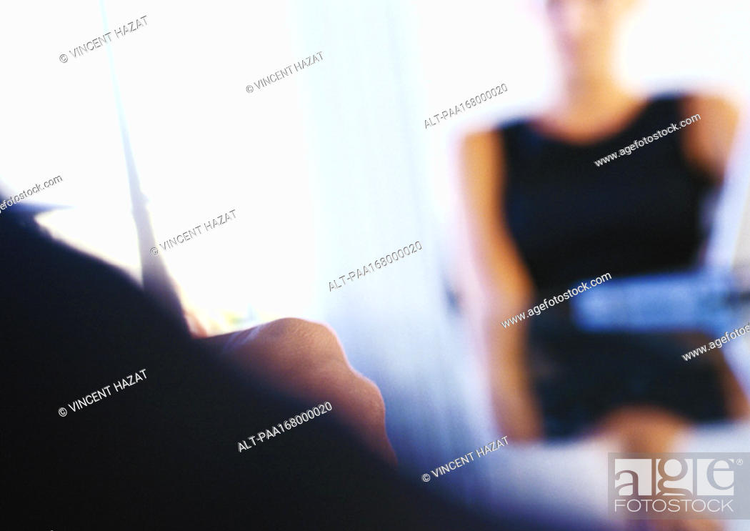 Stock Photo: Woman sitting at table, blurred.