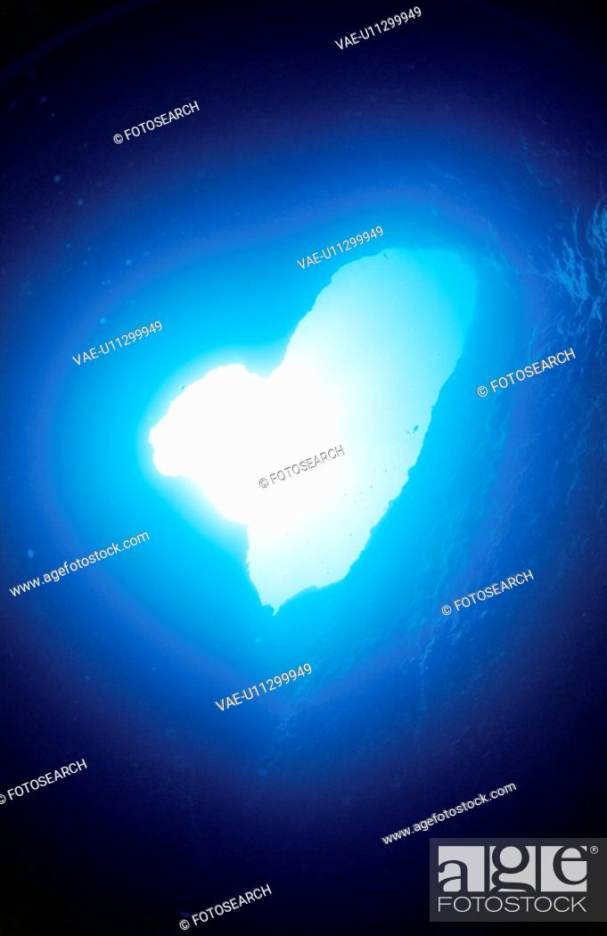 Stock Photo: The Underwater Cave Of A Heart Shape.