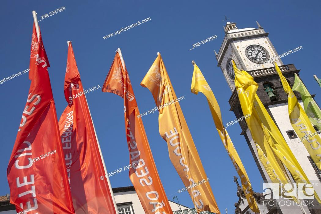 Stock Photo: View of Sao Sebastiao church tower in the downtown of Ponta Delgada and flags with the names of the villages in the municipality. Azores, Portugal.