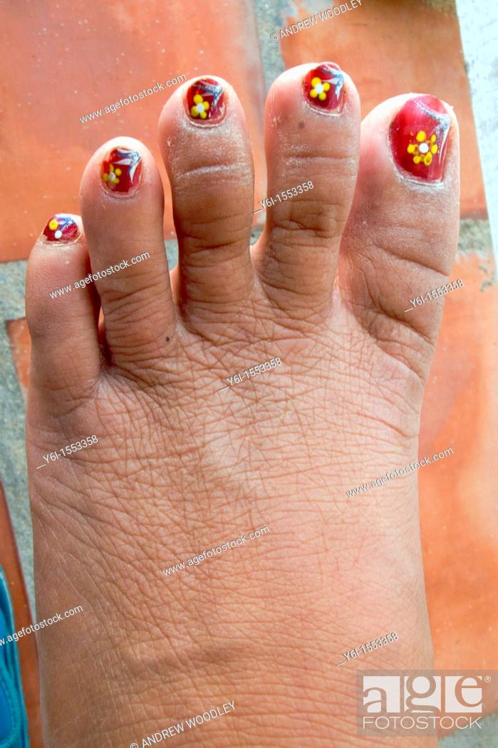 Stock Photo: Yellow flowers painted on toes with nail varnish in Phu Quoc Island Vietnam.