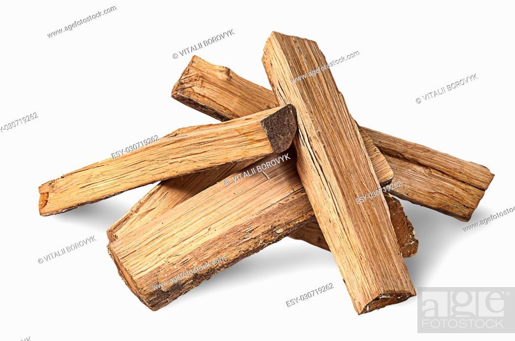 Stock Photo: Pile of firewood isolated on white background.