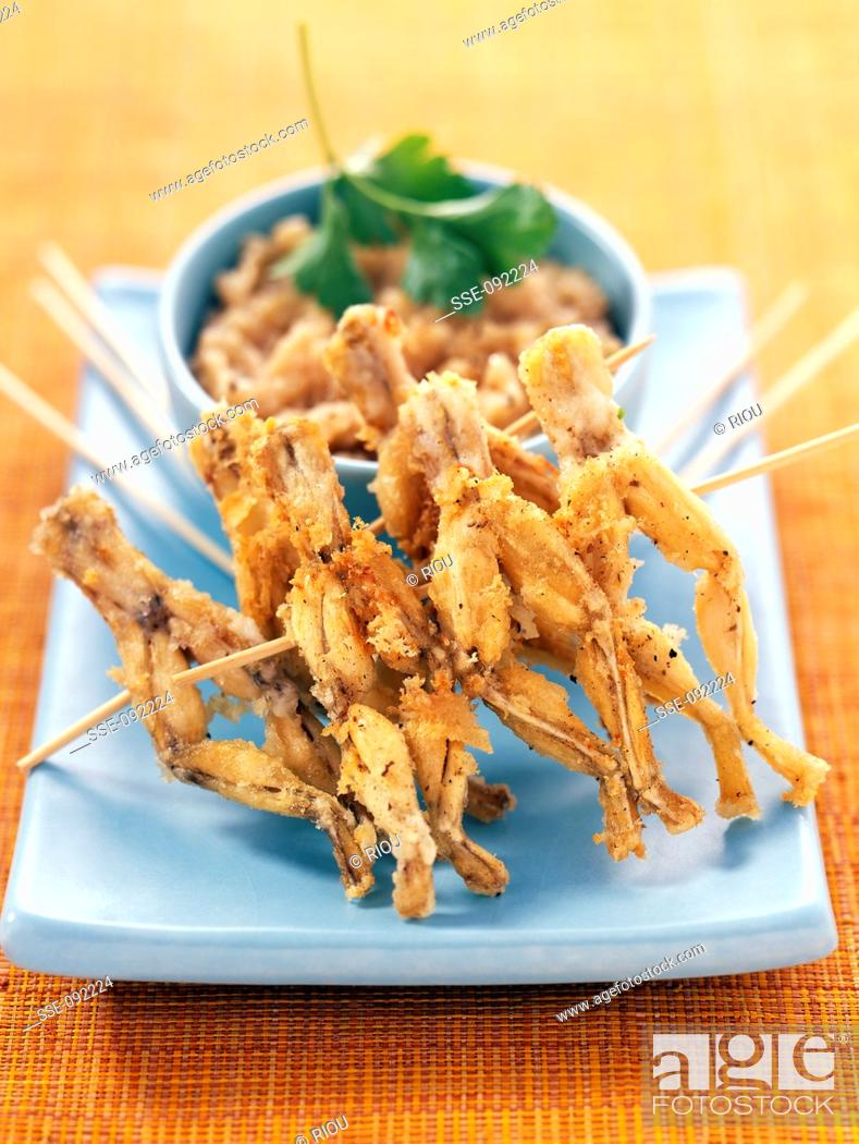 Stock Photo: Frog's legs with shallot cream.