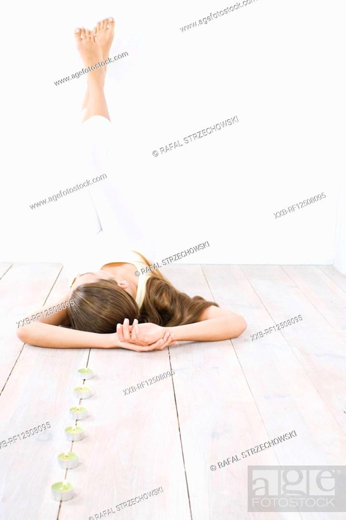 Stock Photo: woman relaxing on floor.