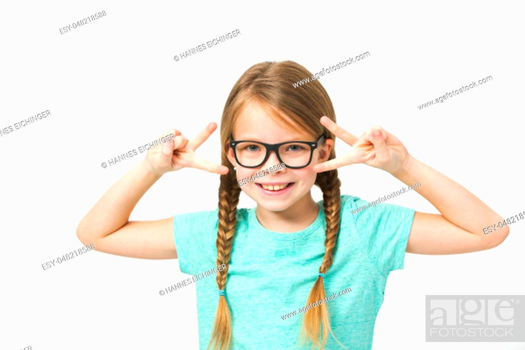 Stock Photo: pretty girl with black glasses and plaits in front of white background in the studio.