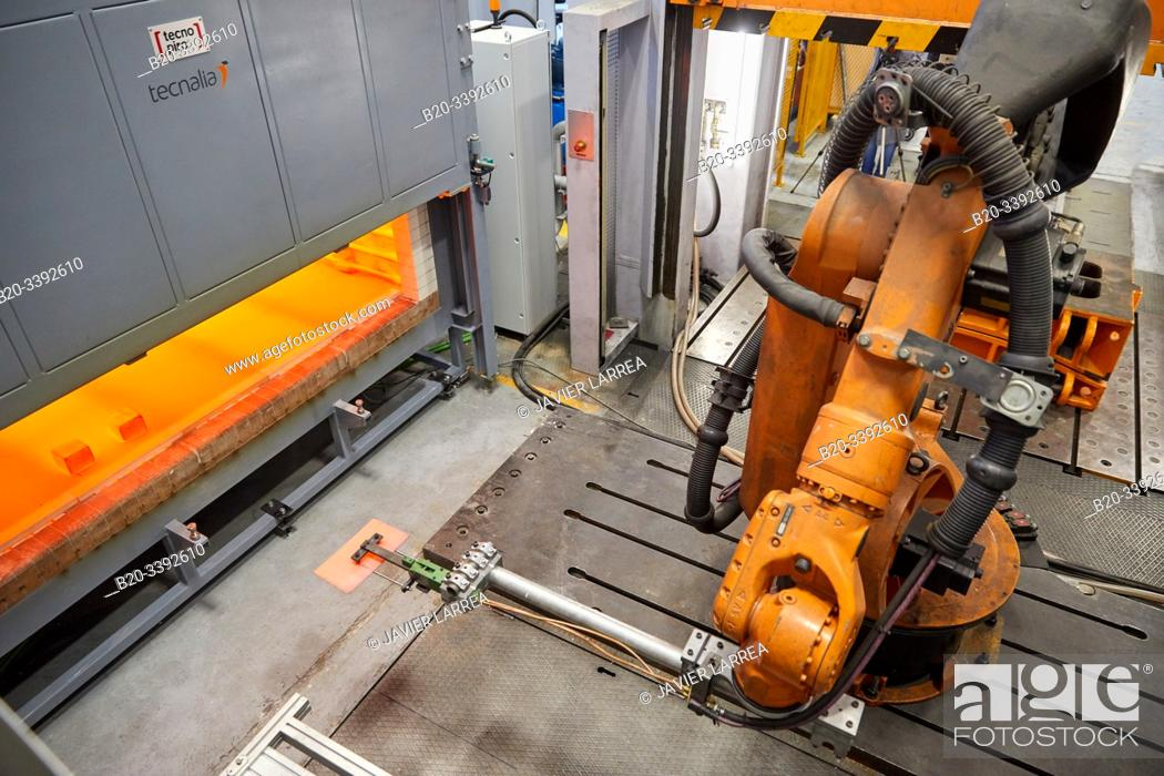 Stock Photo: Robot that introduces materials in the oven and later takes them to the press, Hot stamping cell, Industry Unit, Automotive Industry, Technology Centre.