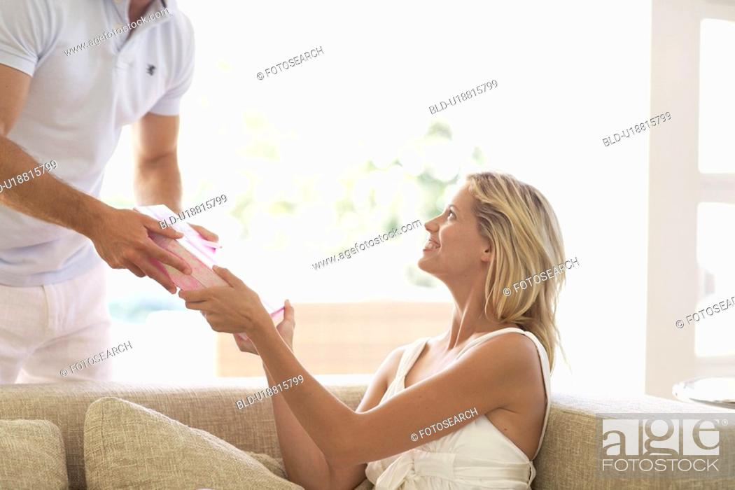 Stock Photo: Man giving present to woman.