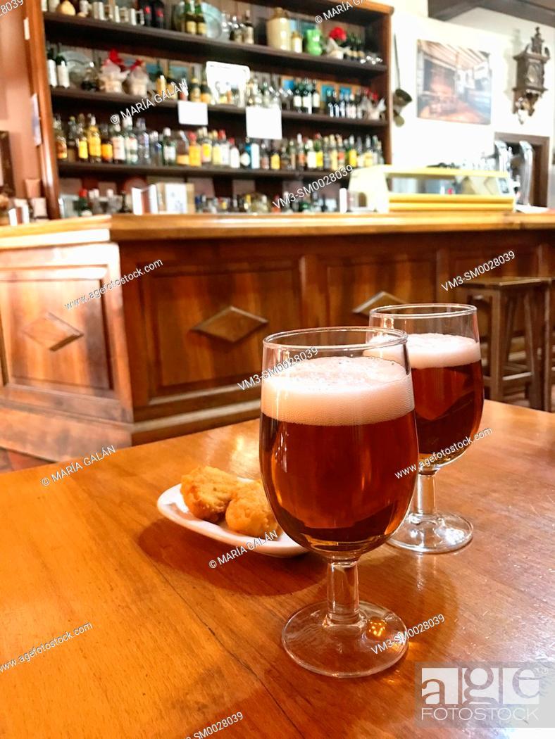 Stock Photo: Two glasses of beer in a traditional tavern. Pedraza, Segovia province, Castilla Leon, Spain.