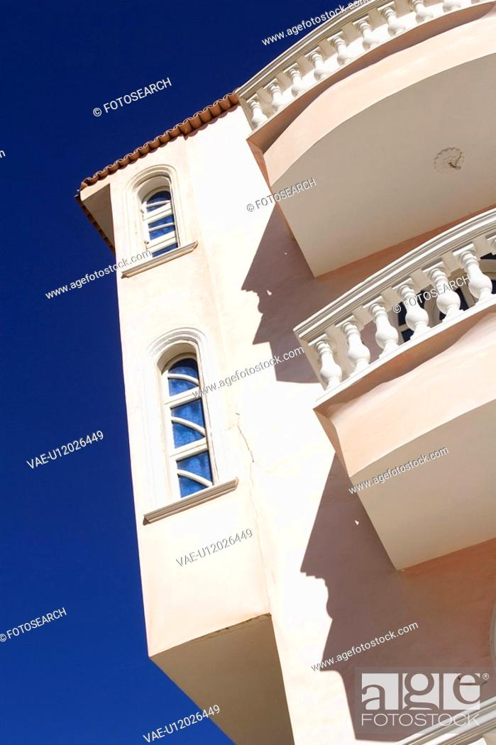 Stock Photo: Balcony, Blue, Building, Building Exterior, Building Structure.