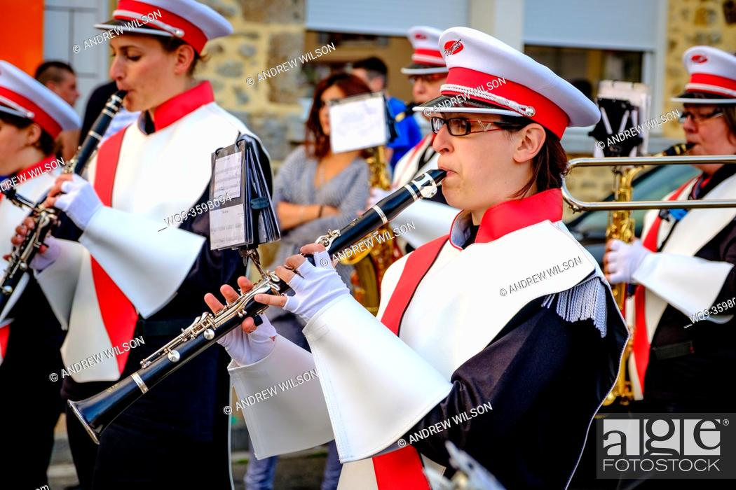 Stock Photo: A clarinet player in the town band plays during Bastille Day celebrations in the town of Villaines-la-Juhel, Pays de la Loire, France.