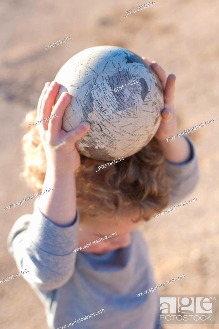 Stock Photo: Boy Holding Globe Of Earth.