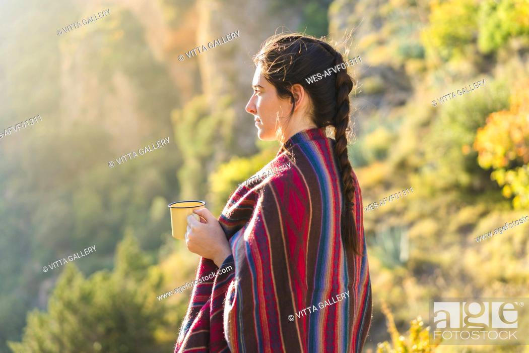 Stock Photo: Spain, Alquezar, young woman with coffee mug in nature.