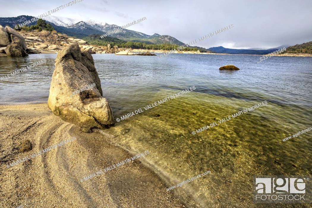 Stock Photo: Burguillo reservoir and Sierra de Gredos on a cloudy day. Avila. Spain. Europe.