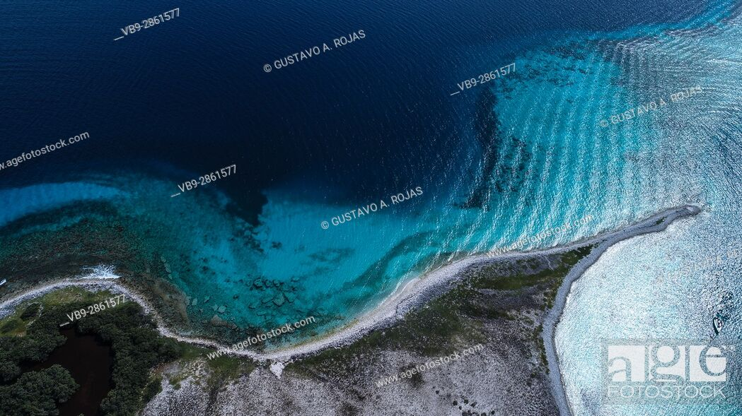 Stock Photo: Aerial view of coral reef fringed Noronky in Los Roques Archipelago.